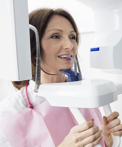 Woman receiving 3 D C T cone beam x-ray scan
