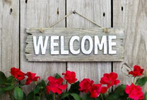 rustic welcome sign greeting patients of periodontist in Mayfield Heights